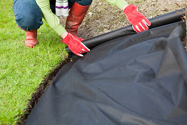 installing landscape fabric